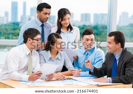 Multi-ethnic business team discussing new project - stock photo