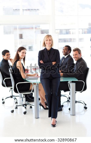 Multi-ethnic business team smiling at the camera in a meeting