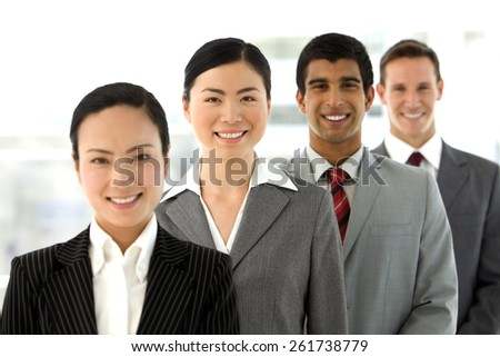 Multi ethnic business team standing in a row.