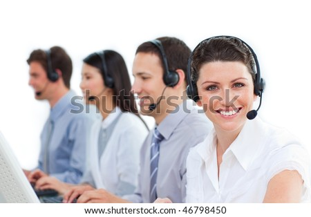 Multi-ethnic business team talking on headset in a call center - stock photo