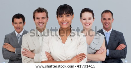 Multi-ethnic business team with folded arms in the office - stock photo