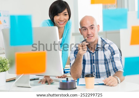 Multi-ethnic business team working together in the office - stock photo