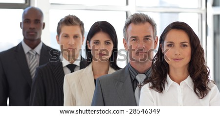 Multi Ethnic Businessgroup looking at Camera - stock photo