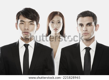 Multi-ethnic businessmen in front of businesswoman - stock photo