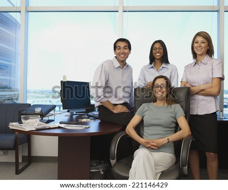 Multi-ethnic businesspeople in office - stock photo