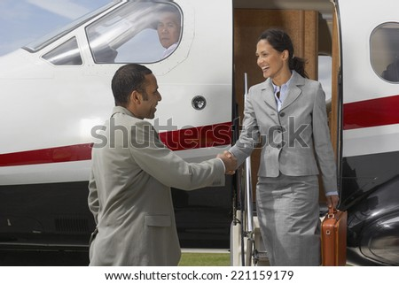 Multi-ethnic businesspeople shaking hands - stock photo