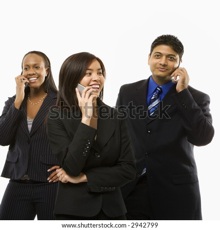 Multi-ethnic businesswomen and businessman standing talking on cell phones. - stock photo