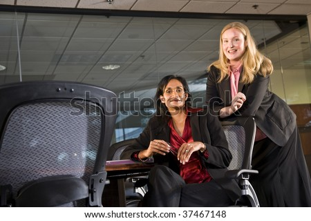 Multi-ethnic businesswomen meeting in conference room - stock photo