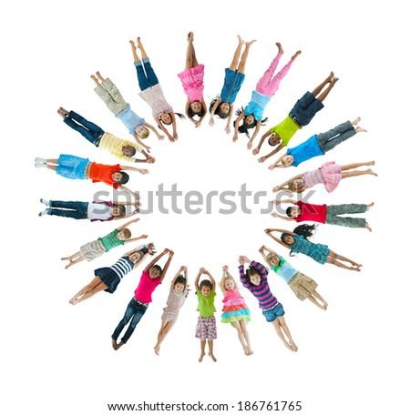 Multi-Ethnic Children Lying Down Forming Circle - stock photo