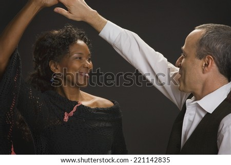 Multi-ethnic couple dancing - stock photo