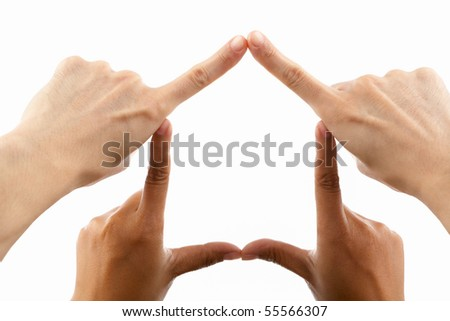 Multi ethnic couple's hands forming house symbol, against white background