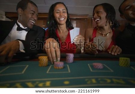 Multi-ethnic couples gambling - stock photo