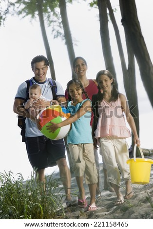 Multi-ethnic family at beach - stock photo