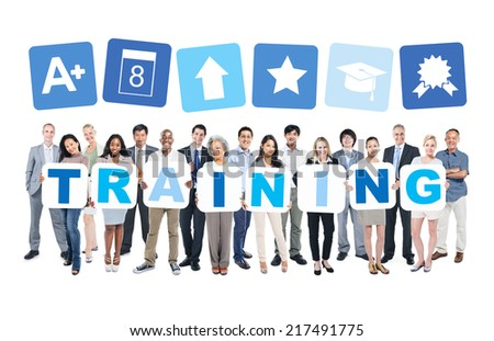 Multi-ethnic group of business and casual people holding cardboards forming training and related symbols above. - stock photo