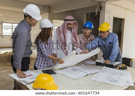 Multi ethnic group business team construction stock photo 601647734 multi ethnic group of business team construction engineer architect and worker looking building model and blueprint malvernweather Images