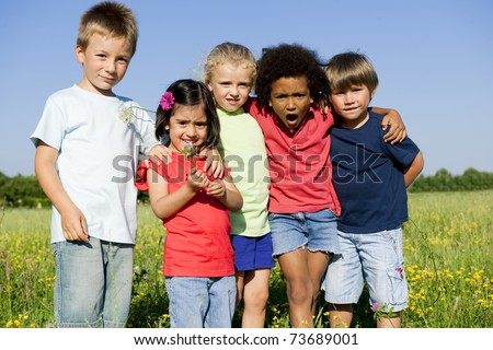 Multi-Ethnic group of children outdoors - stock photo