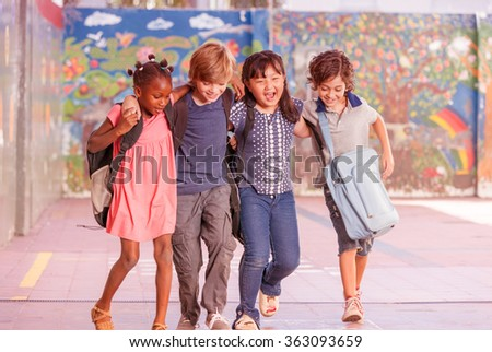 Multi ethnic group of children playing together. Success and integration concept. - stock photo