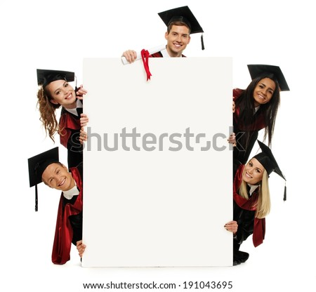 Multi ethnic group of graduated young students with blank notice board - stock photo