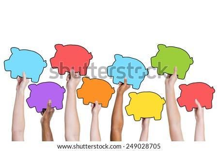 Multi-Ethnic Group of Hands Holding Piggy Bank Symbols - stock photo