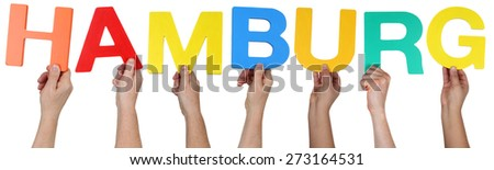 Multi ethnic group of people holding the word Hamburg isolated - stock photo