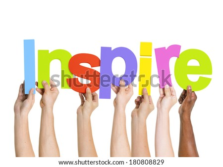 Multi-Ethnic Group Of People Holding The Word Inspire - stock photo