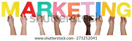 Multi ethnic group of people holding the word marketing isolated - stock photo