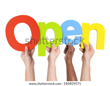 Multi-Ethnic Group Of People Holding The Word Open - stock photo