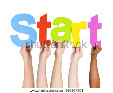 Multi-Ethnic Group Of People Holding The Word Start - stock photo
