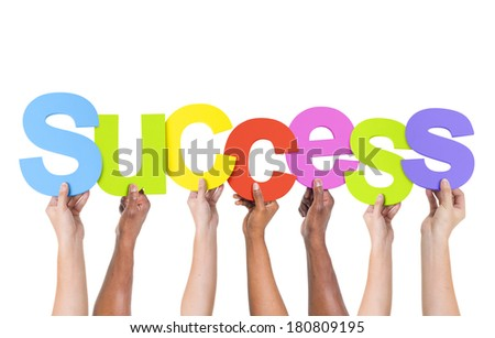 Multi-Ethnic Group Of People Holding The Word Success - stock photo