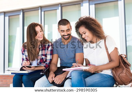 Multi-Ethnic group of students in School Campus - stock photo