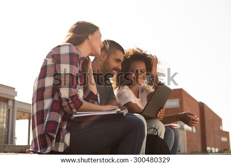 Multi-Ethnic group of students with laptop in campus - Soft sunset Light - stock photo