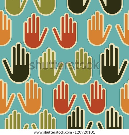 Multi-Ethnic human hands seamless pattern background.