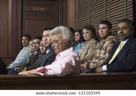 Multi ethnic jurors in witness stand of court house - stock photo