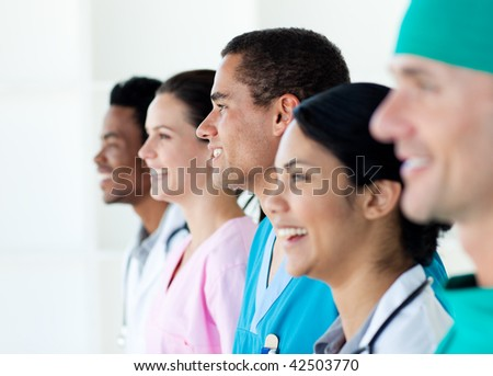 Multi-ethnic medical team standing in a line isolated on a white background