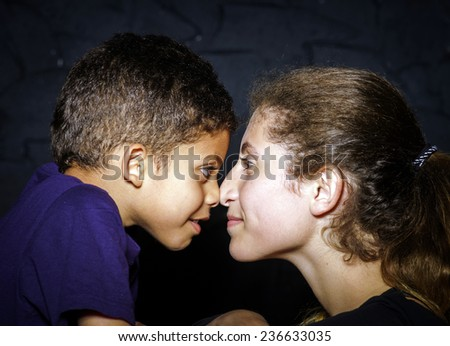Multi-ethnic sister and brother face-to-face portrait