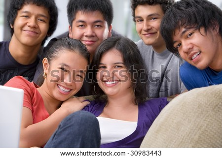 Multi-ethnic students in pose together showing their youthful and friendship - stock photo