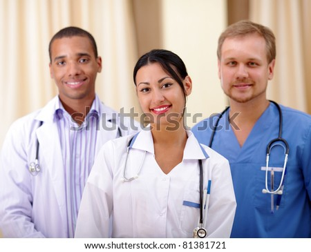 Multi-ethnic team of confident happy doctors