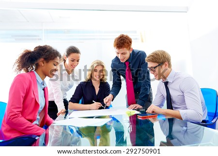 Multi ethnic teamwork of young business people meeting working at office - stock photo