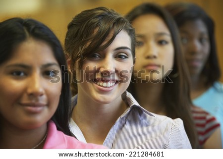 Multi-ethnic teenaged girls in row - stock photo