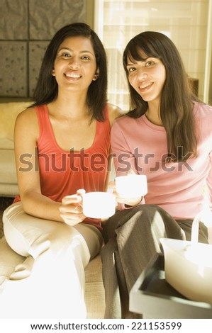 Multi-ethnic women drinking coffee - stock photo