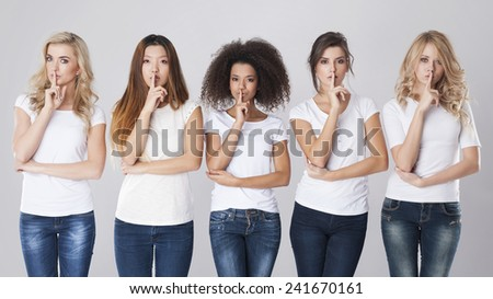 Multi ethnic women with silence sign   - stock photo