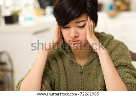 Multi-ethnic Young Woman Rubbing Her Temples Because of Stress. - stock photo