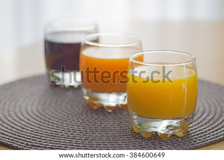 Multi fruit citrus juice from oranges, lemons, bananas, grapes in a glass