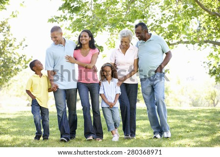 Multi Generation African American Family Walking In Park