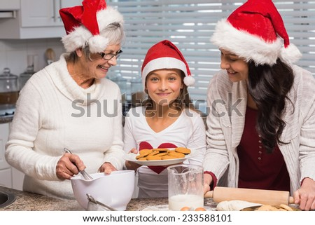Multi-generation family baking together at home in the kitchen - stock photo