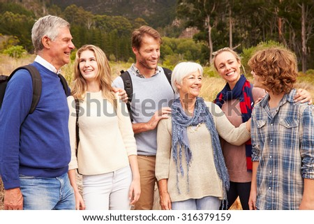 Multi-generation family bonding with each other in a forest - stock photo