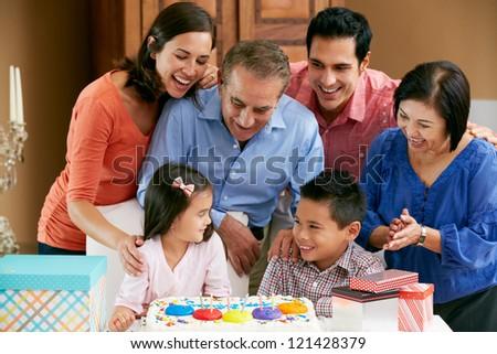 Multi Generation Family Celebrating Children's Birthday - stock photo