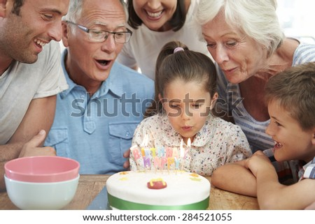 Multi Generation Family Celebrating Daughter's Birthday - stock photo