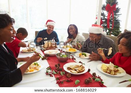 Multi Generation Family Enjoying Christmas Meal At Home - stock photo