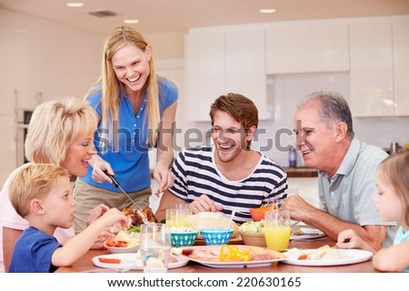 Multi Generation Family Enjoying Meal At Home Together - stock photo